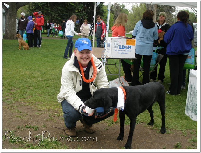 Chris and Mizar at the Arthritis Walk. Mizar is eating a GoodTimes Pawbender and ate it 3 minutes flat.